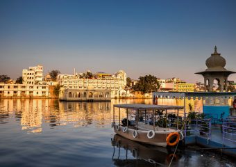 Views of City Palace and Lake Pichola at sun set in Udaipur in Rajasthan in India